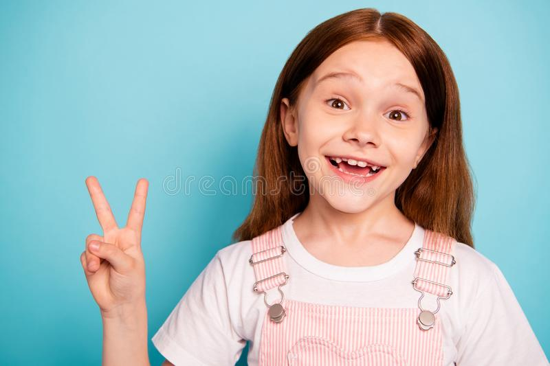 Portrait of excited child make v-signs laugh laughter isolated blue background. Portrait of excited child, make v-signs laugh laughter isolated blue background royalty free stock photography