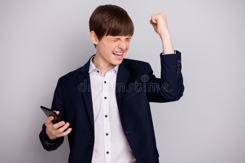 Portrait of excited delighted teen teenager raise fist scream yeah have aims contest learning courses wear black trendy. Portrait of excited delighted teen royalty free stock images