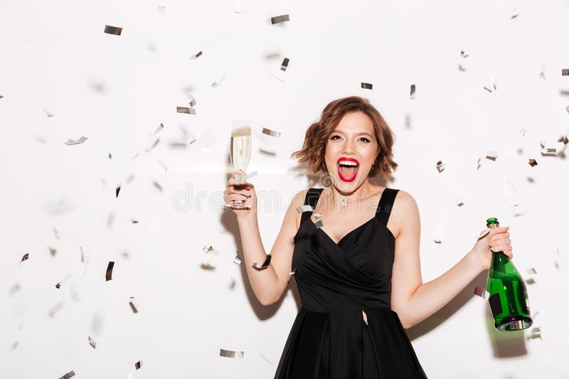 Download Portrait Of An Excited Girl Dressed In Black Dress Stock Image - Image of party, champagne: 109294855