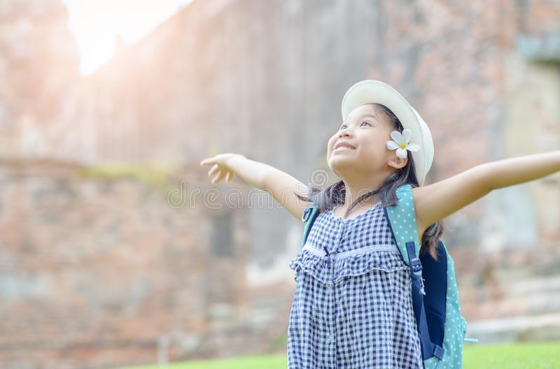 Portrait of an excited girl raising arms and laughing stock photography