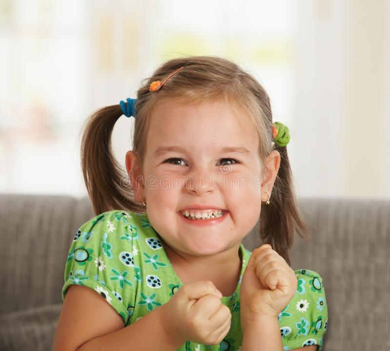Portrait of excited little girl stock images