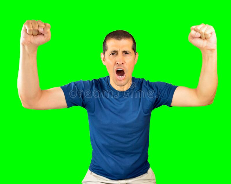 Screaming for the victory. Portrait of an excited man with hands raised isolated cutout on green background with chroma key royalty free stock photos