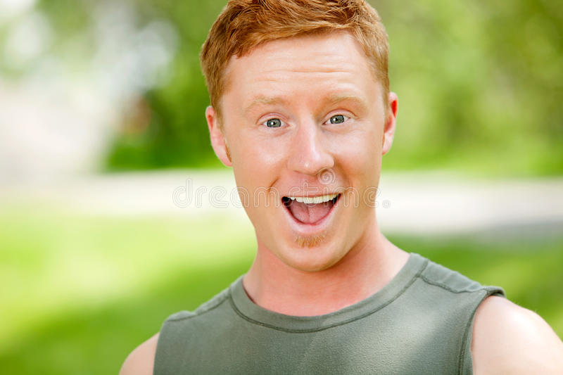 Portrait of excited man with mouth open royalty free stock photo