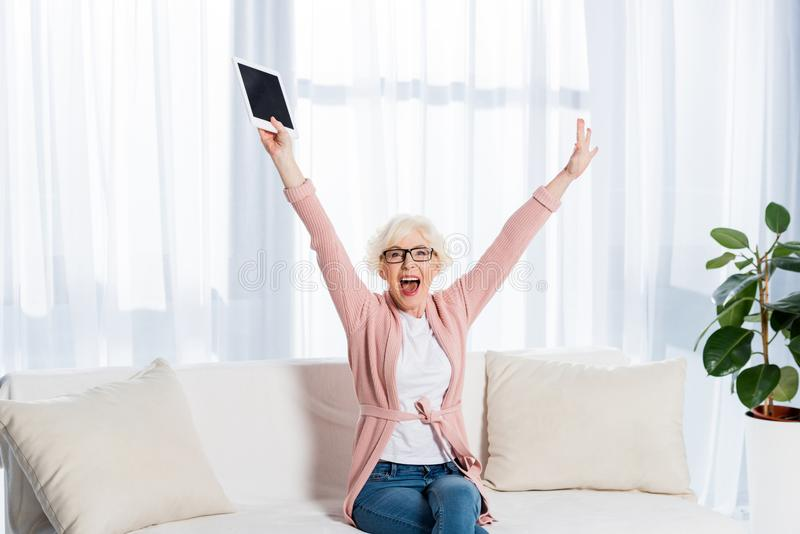 portrait of excited senior woman stock images