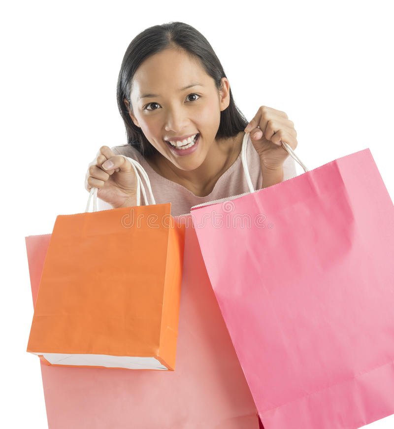 Portrait Of Excited Woman Carrying Shopping Bags Royalty Free Stock Images