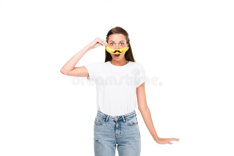 portrait of excited woman holding fresh banana with mustache sign royalty free stock images
