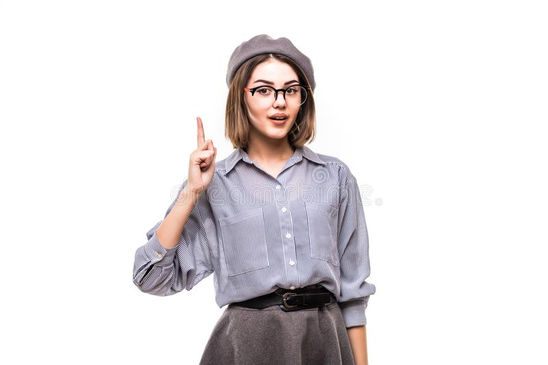 Portrait of an excited woman wearing beret pointing finger up isolated over white background stock photo