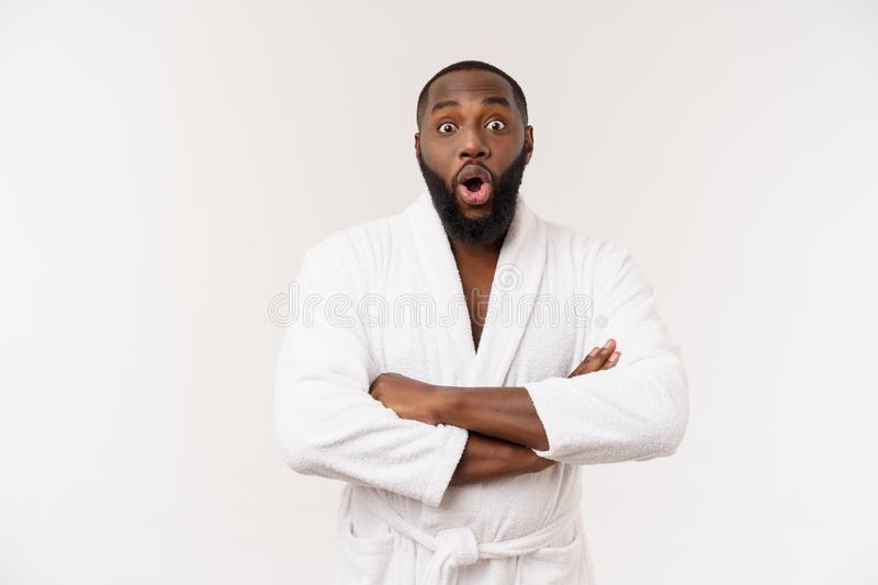 Portrait of excited young African American male screaming in shock and amazement holding hands on head. Surprised black royalty free stock image