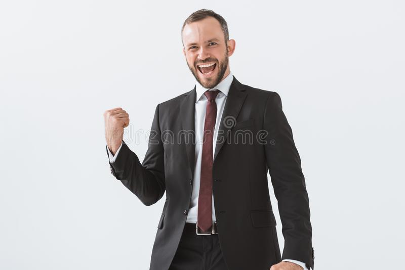portrait of excited young businessman looking at camera royalty free stock photos