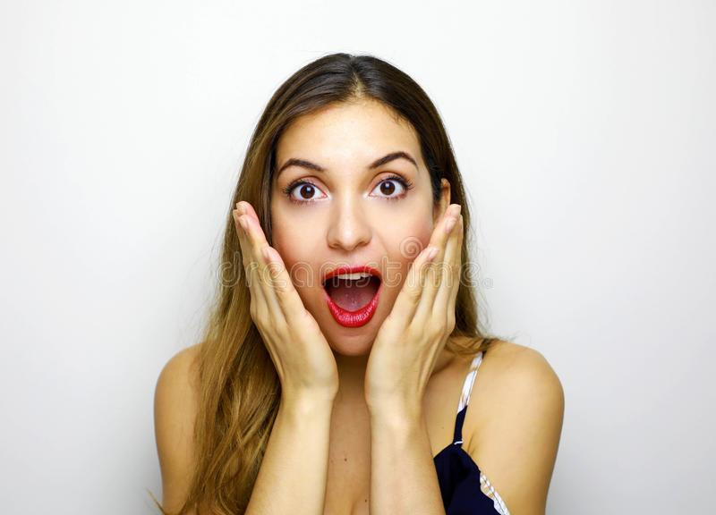 Portrait of excited young woman hands near face keeping mouth open isolated on white background. People sincere emotions lifestyle stock photos
