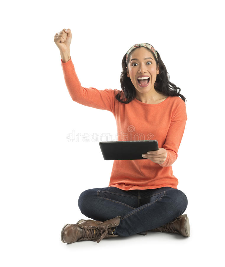 Download Portrait Of Excited Young Woman Holding Digital Tablet Stock Image - Image: 32482071