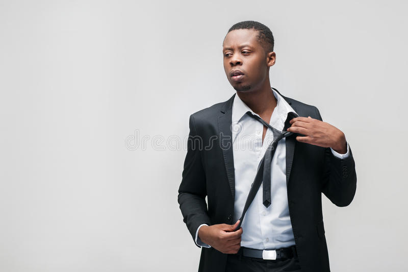 Portrait of exhausted african american office guy royalty free stock photography