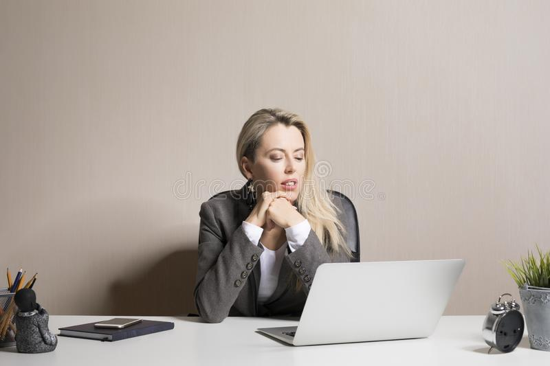Portrait of an exhausted businesswoman looking at the laptop screen stock photo
