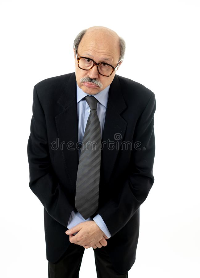 Portrait of exhausted senior man with sad and worried expression overworked and tired stock photo