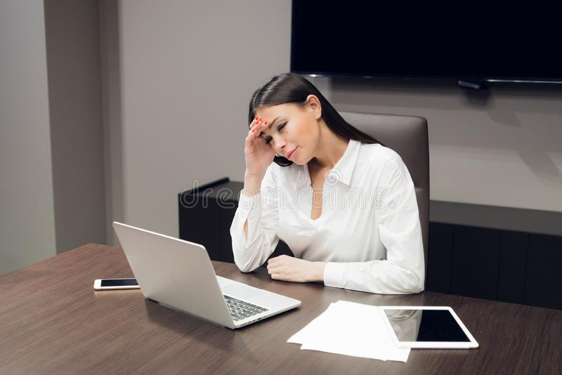 Portrait of exhausted and tired business woman in the office. Depression, sadness, problems, difficulties concept stock photos