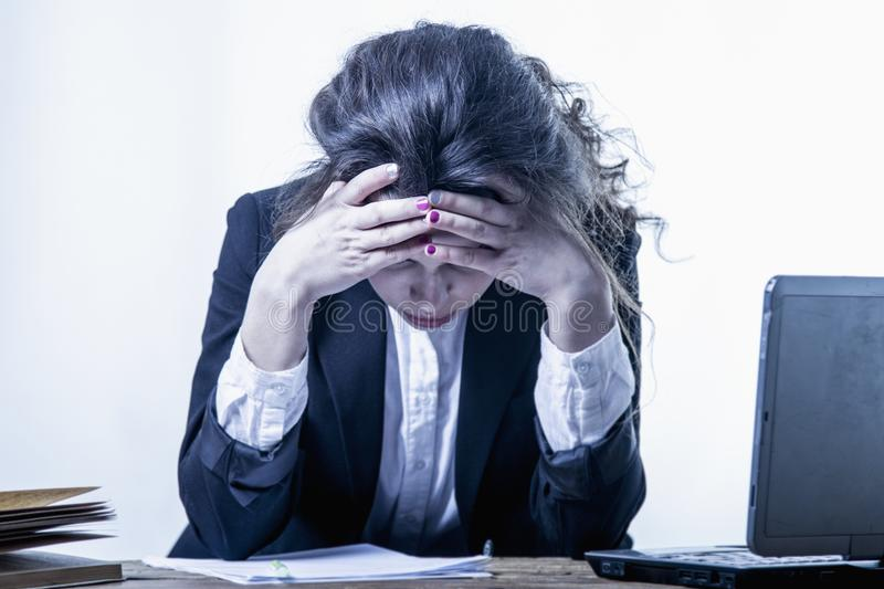 Portrait of exhausted and tired business woman in the office Depression, sadness, problems, difficulties concept stock image