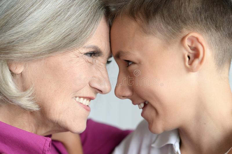 Portrait of exited grandmother and grandson. At home stock images
