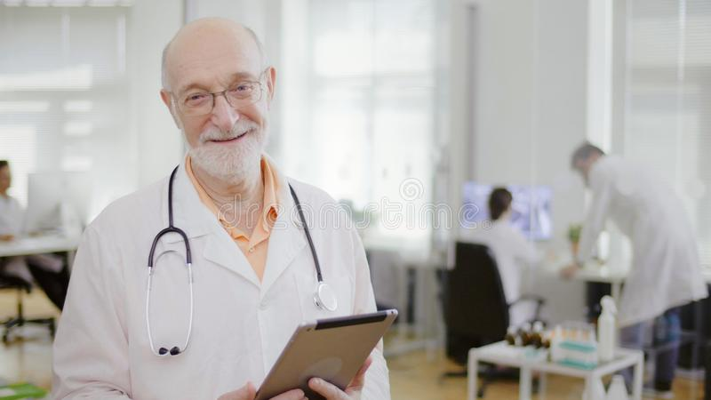 Close up of experienced smiling doctor royalty free stock images