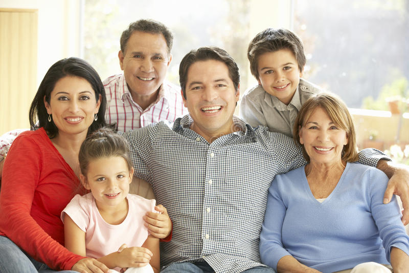 Portrait Of Extended Hispanic Family Relaxing At Home stock image