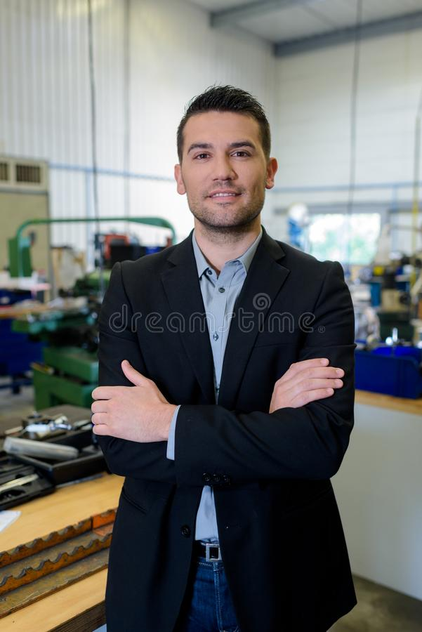 Portrait factiry manager wearing jeans and blazer stock photo