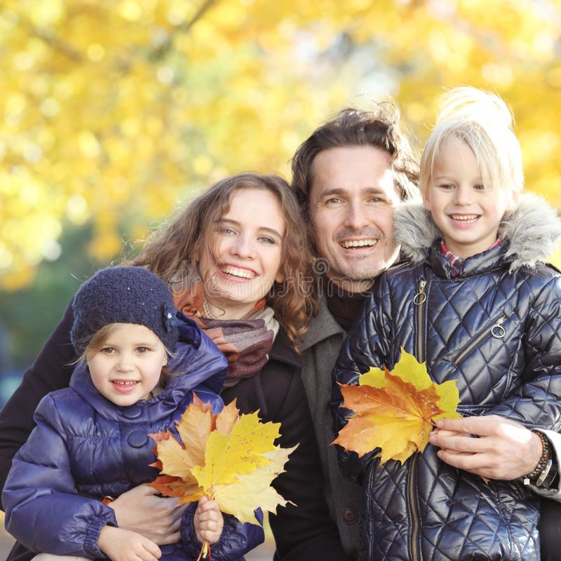 Portrait of family in autumn park royalty free stock photos