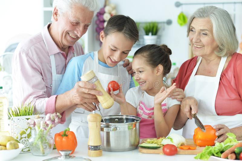 Portrait of family cooking together in kitchen royalty free stock photography