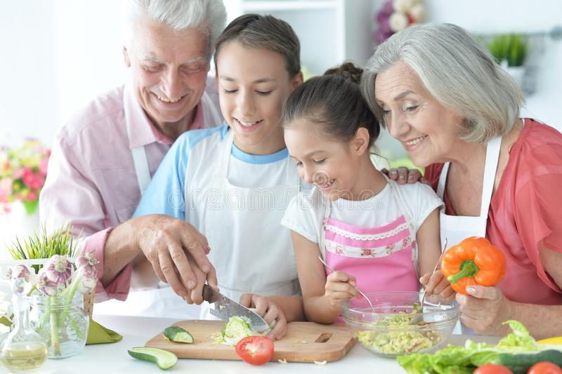 Portrait of family cooking together in kitchen stock image