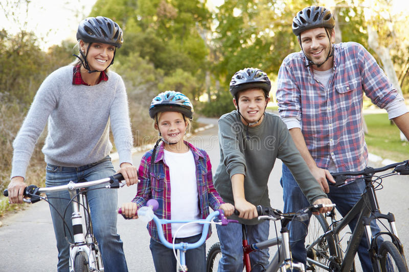 Portrait Of Family On Cycle Ride In Countryside. Smiling royalty free stock photos