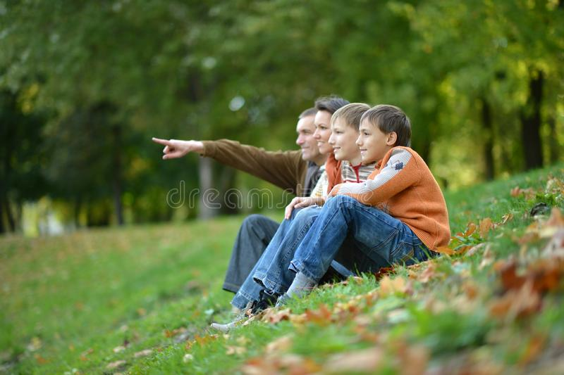 Portrait of family of four in autumn park royalty free stock image