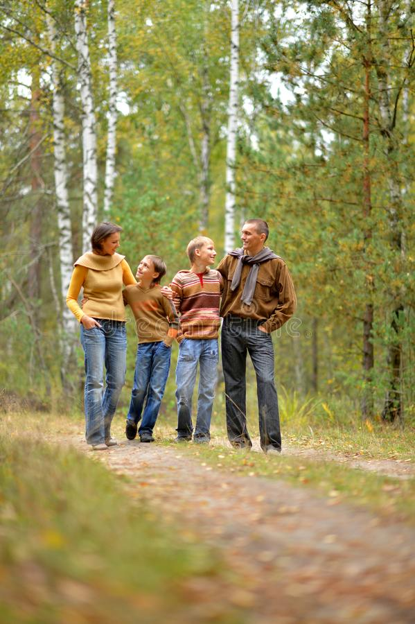 Portrait of family of four in park stock photography