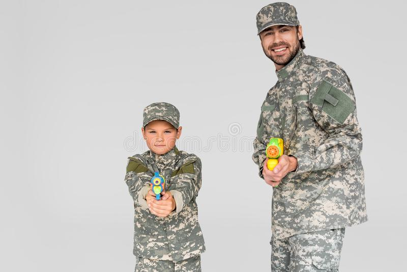 portrait of family in military uniform with water guns in hands stock photos