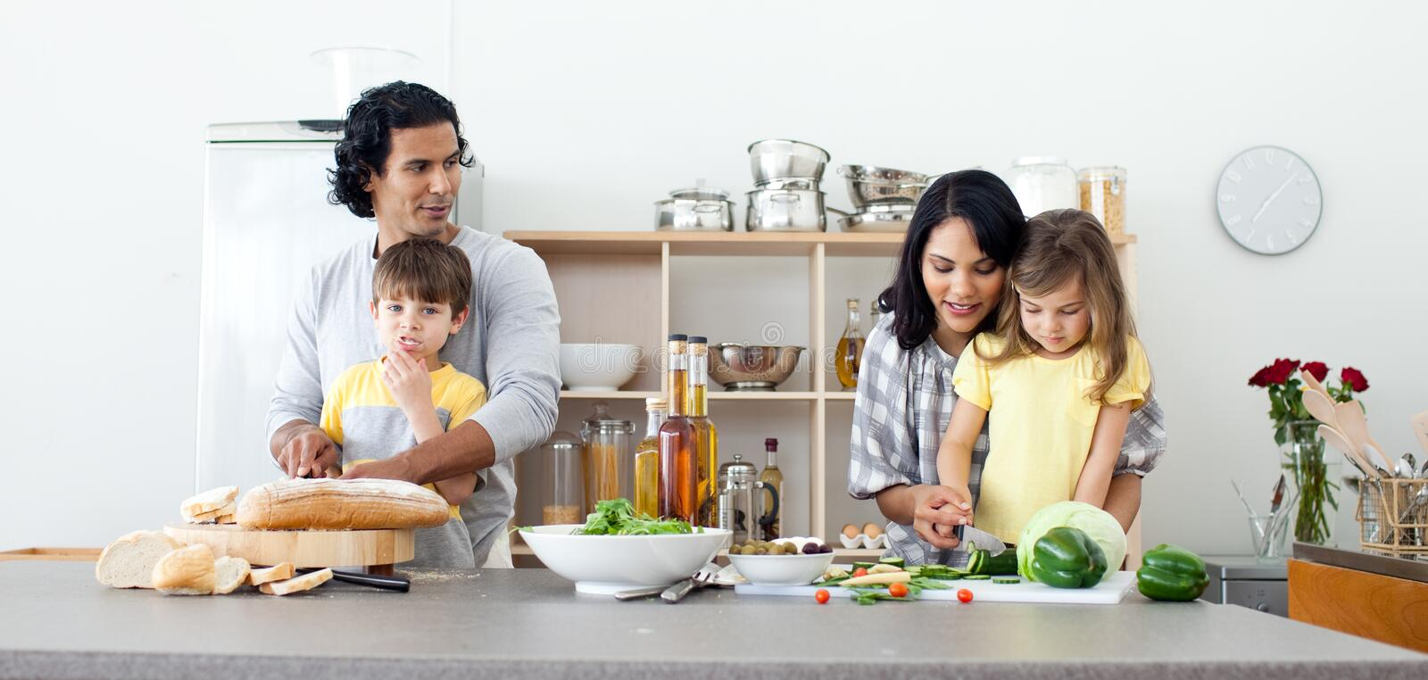 Portrait of a family preparing lunch stock image