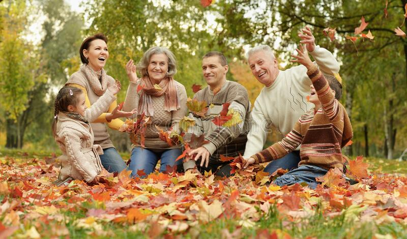 Portrait of family relaxing in autumn park stock images