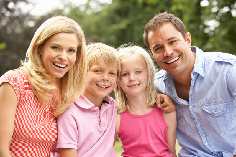 Portrait Of Family Relaxing In Countryside royalty free stock images