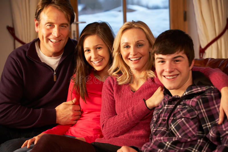 Portrait Of Family Relaxing On Sofa Together Stock Photo