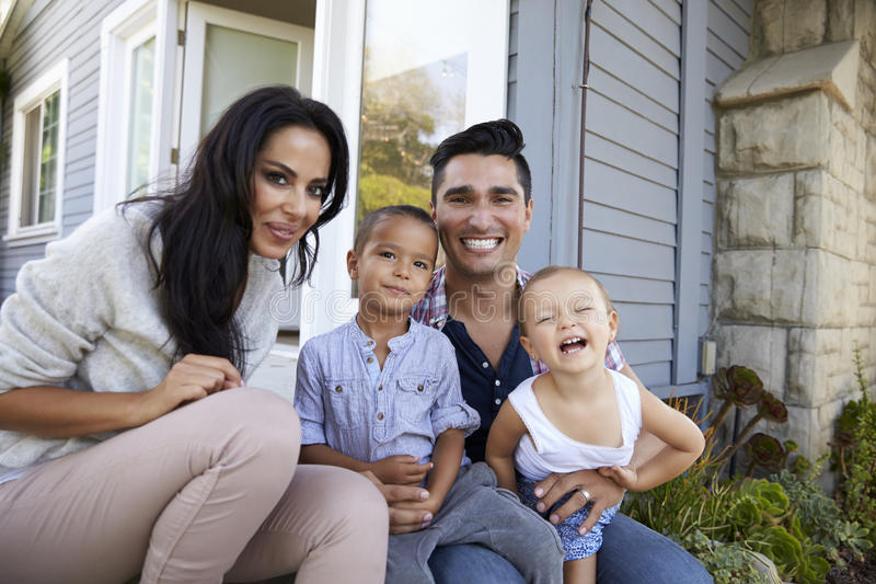Portrait Of Family Sitting On Steps Outside Home stock images