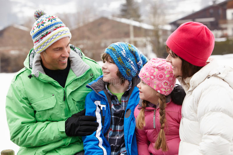 Portrait Of Family In Snowy Landscape royalty free stock photo