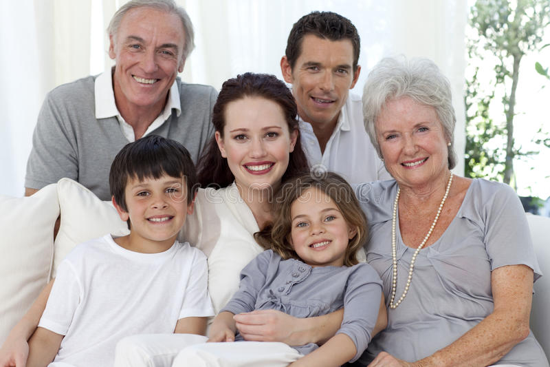 Portrait of family on sofa stock photos