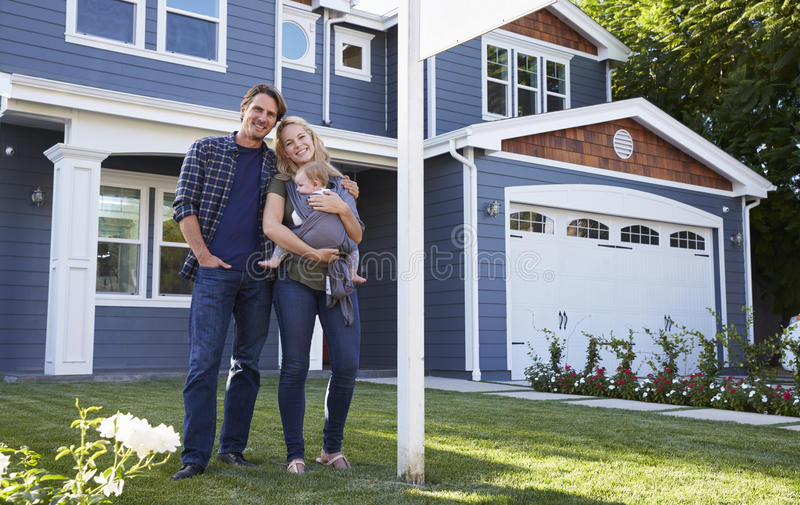 Portrait Of Family Standing Outside House royalty free stock photos