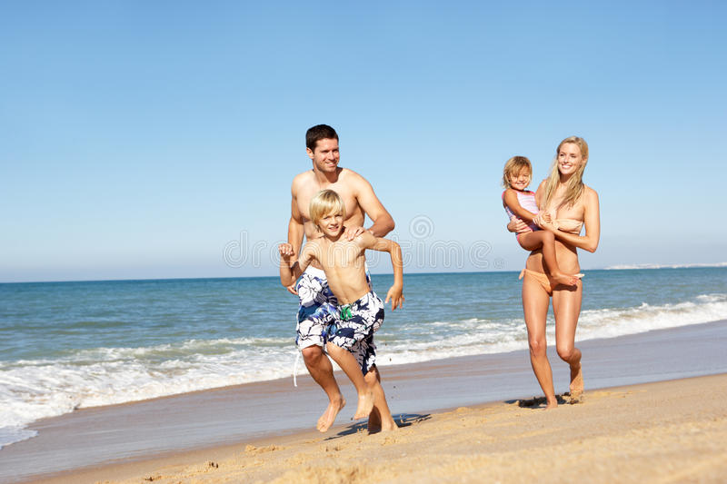 Download Portrait Of Family On Summer Beach Holiday Stock Photo - Image of parent, girl: 16615444