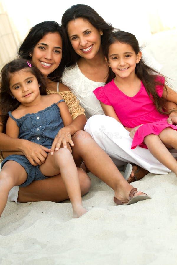 Three generations of hispanic woman smiling. stock photography