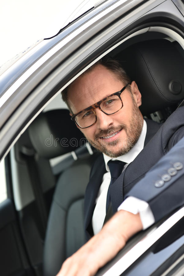Portrait of fancy taxi driver royalty free stock photo