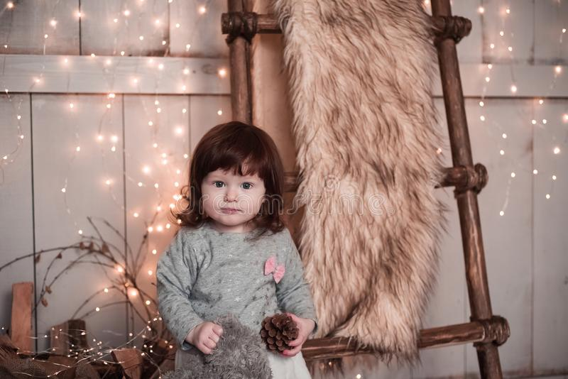Portrait of the fantastic little red-haired girl. Christmas interior royalty free stock images