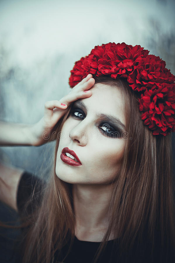 Portrait of Fashion Beautiful Woman on Nature. Pure Beauty Mode. L Girl. Perfect bright smoky Makeup. With Flower Wreath. Cold toning. Punk, rock, gothic royalty free stock image