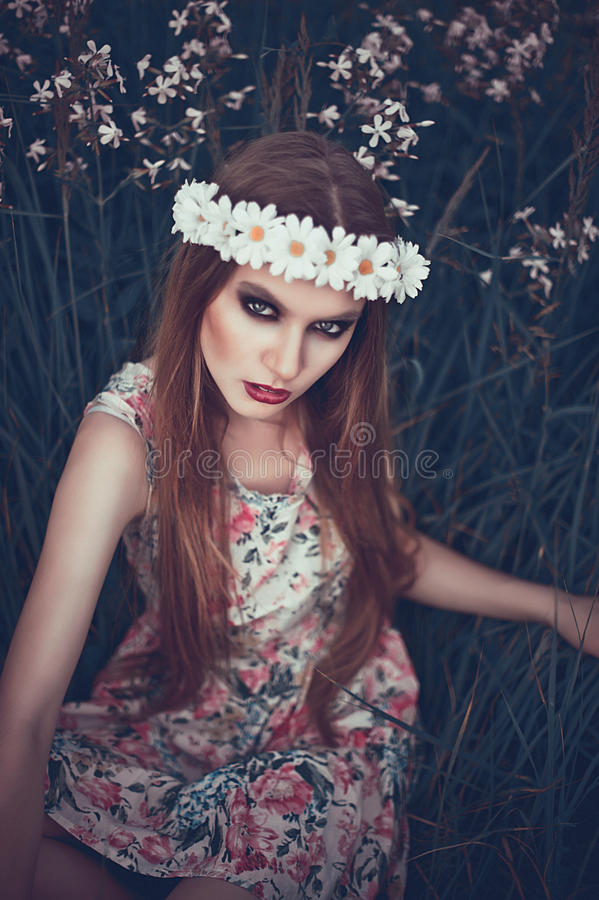 Portrait of Fashion Beautiful Woman on Nature. Pure Beauty Mode. L Girl. Perfect bright smoky Makeup. With Flower Wreath. Cold toning. Punk, rock, gothic stock image