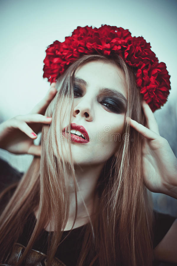 Portrait of Fashion Beautiful Woman on Nature. Pure Beauty Mode. L Girl. Perfect bright smoky Makeup. With Flower Wreath. Cold toning. Punk, rock, gothic stock images