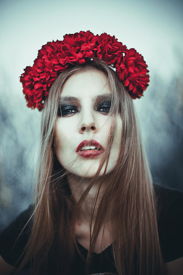 Portrait of Fashion Beautiful Woman on Nature. Pure Beauty Mode. L Girl. Perfect bright smoky Makeup. With Flower Wreath. Cold toning. Punk, rock, gothic royalty free stock photos