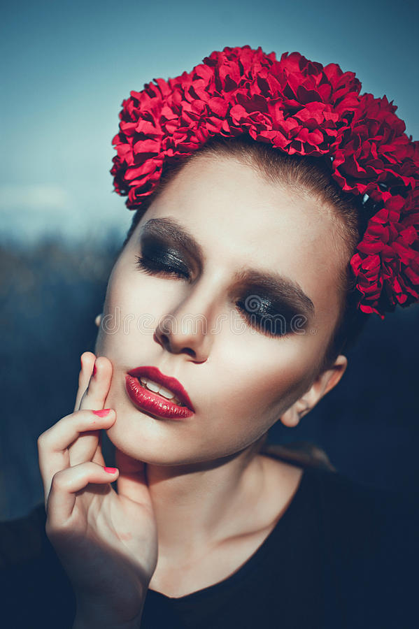 Portrait of Fashion Beautiful Woman on Nature. Pure Beauty Mode. L Girl. Perfect bright smoky Makeup. With Flower Wreath. Cold toning. Punk, rock, gothic royalty free stock photo