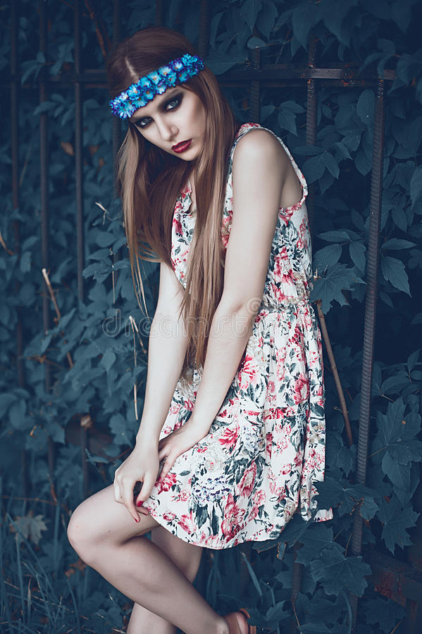 Portrait of Fashion Beautiful Woman on Nature. Pure Beauty Mode. L Girl. Perfect bright smoky Makeup. With Flower Wreath. Cold toning. Punk, rock, gothic royalty free stock photography