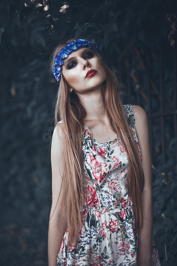 Portrait of Fashion Beautiful Woman on Nature. Pure Beauty Mode. L Girl. Perfect bright smoky Makeup. With Flower Wreath. Cold toning. Punk, rock, gothic stock photos
